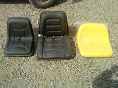 asiento tractor roto
